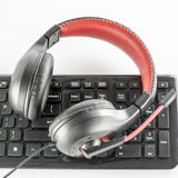 Keyboard computer and headphone. On a white background stock image