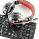 Keyboard computer and headphone. On a white background royalty free stock photography