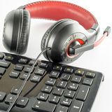 Keyboard computer and headphone. On a white background royalty free stock photos