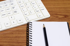 Keyboard computer with notenook and pencil Stock Image