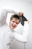 Keyboard Concept 7. High Key - Portrait of a young man hitting with computer keyboard stock image