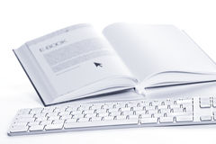 Keyboard connected to E-book Royalty Free Stock Photo