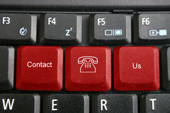 Keyboard, contact us. Computer keyboard withtelephone symbol and contact us text Royalty Free Stock Image