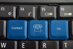 Keyboard - contact us. Computer keyboard with contact us on blue keys royalty free stock photos