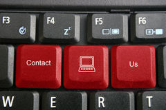 Keyboard, contact us. Contact us text and mouse logo on keyboard stock photos