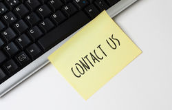 Keyboard and Contact Us Sticky Note Stock Photo
