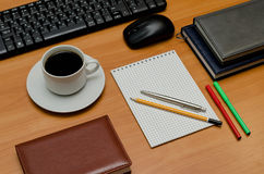 Keyboard, cup of coffee and office supplies Royalty Free Stock Images