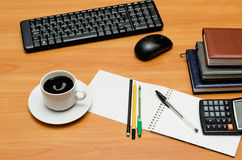 Keyboard, cup of coffee and office supplies Stock Image