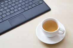 Keyboard and a cup of tea Stock Photography