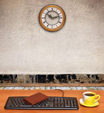 Keyboard on desk and a business clock in old room Royalty Free Stock Image
