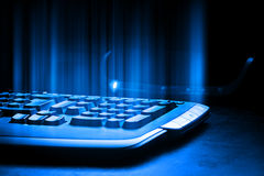 Keyboard detail. Close up image with a glowing  keyboard Royalty Free Stock Photos