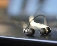 Keyboard with earplugs Royalty Free Stock Image