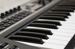 The keyboard of the electronic piano. stock photos