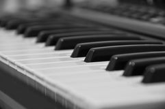 The keyboard of the electronic piano. Small DOF. Royalty Free Stock Images