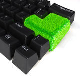 Keyboard with enter button in green grass Stock Images
