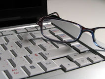 Keyboard with eyeglasses Stock Image