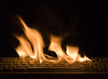 Keyboard fire. Fire flame on keyboard isolated on black background Royalty Free Stock Photos