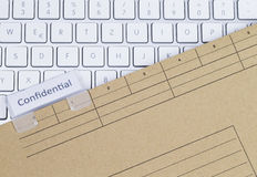 Keyboard and folder confidential Royalty Free Stock Photo