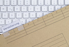 Keyboard and folder insurance Royalty Free Stock Images