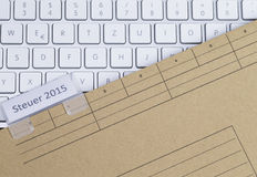 Keyboard and folder tax 2015 Royalty Free Stock Photo