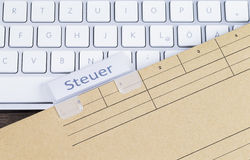 Keyboard and folder tax Royalty Free Stock Images