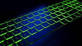 Keyboard Gamer with green and blue backlight. Modern gaming computer royalty free stock photos