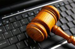 Keyboard gavel. Judges legal court gavel closeup  on a laptop Stock Images