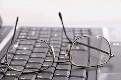 Keyboard and glasses Stock Images