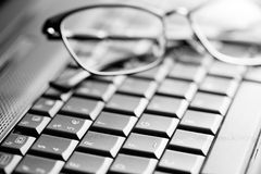Keyboard and glasses Stock Image