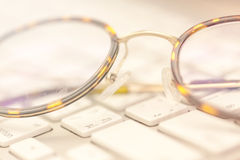 Keyboard and glasses Royalty Free Stock Images