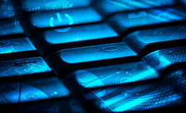 Keyboard with glowing charts Stock Image