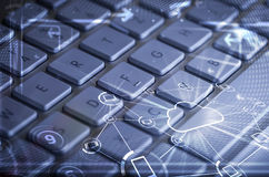 Keyboard with glowing cloud technology icons Royalty Free Stock Photos