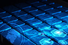 Keyboard with glowing multimedia icons Stock Photo