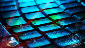 Keyboard with glowing social network icons. Computer keyboard with glowing icons, social networking concept Stock Photography