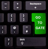 Keyboard go to gate. Keyboard with green enter button, spelling go to gate Stock Image