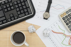 Keyboard, graph, calculator, wristwatch, and coffee Royalty Free Stock Image