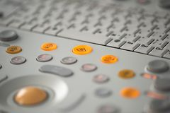 Control panel and keyboard of a modern ultrasonic scanner. Keyboard with gray and orange buttons on the control panel of a modern ultrasonic device stock photos