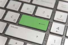 Keyboard with green blank Enter button modern pc text communicaton Royalty Free Stock Photo