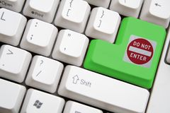 Keyboard with green do not enter button. Concept of keyboard with green do not enter button Stock Images