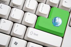 Keyboard with green earth button. Concept of keyboard with green earth button Stock Image