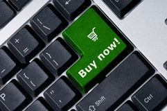 Keyboard with green key Buy now Stock Photos