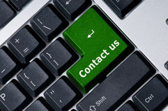 Keyboard with green key Contact us Stock Photo