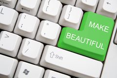 Keyboard with green MAKE BEAUTIFUL button Royalty Free Stock Photo