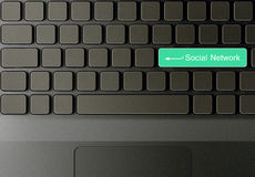 Keyboard with Green social network button Royalty Free Stock Images