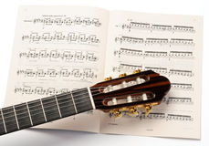Keyboard of guitar and score Stock Photo