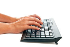 Keyboard and hands Stock Images