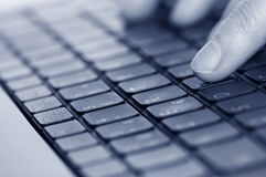 Keyboard and hands close up Stock Images