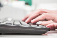 Keyboard and hands working Stock Photo