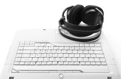 Keyboard with headphones Stock Images