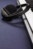 Keyboard and headphones Stock Image